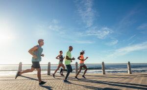 Group of beginner runners running outside