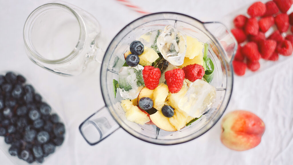 Making a healthy smoothie with fresh fruit