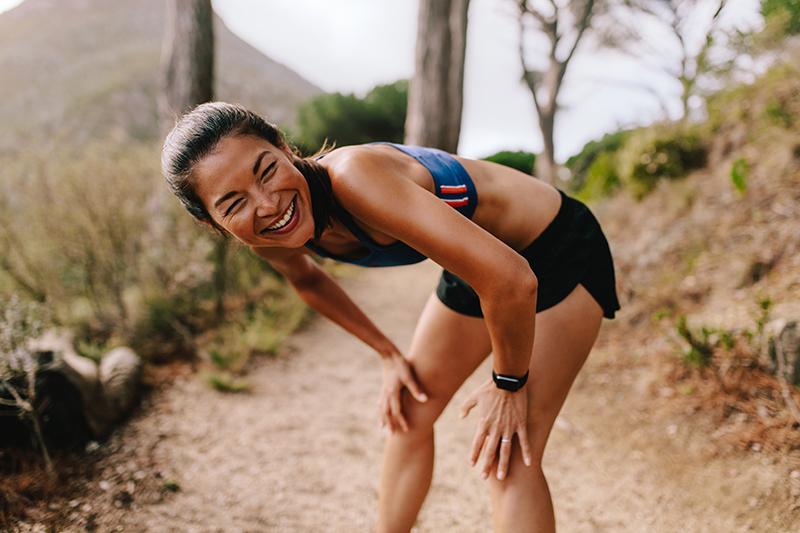 Female runner taking break from fartllek workout