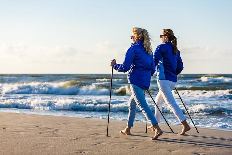 Women Nordic walking on beach