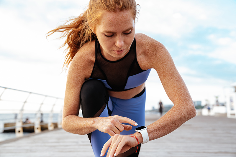 Woman taking break from HIIT workout