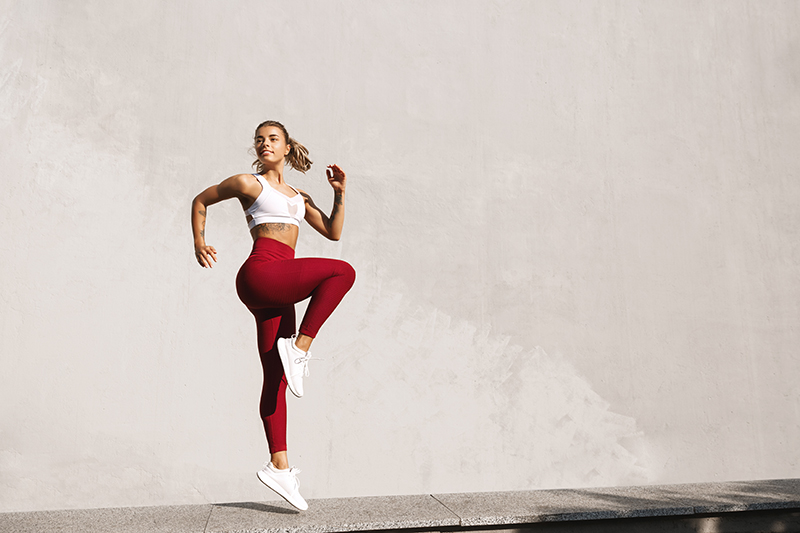 Woman doing HIIT Workout Jumping Exercise