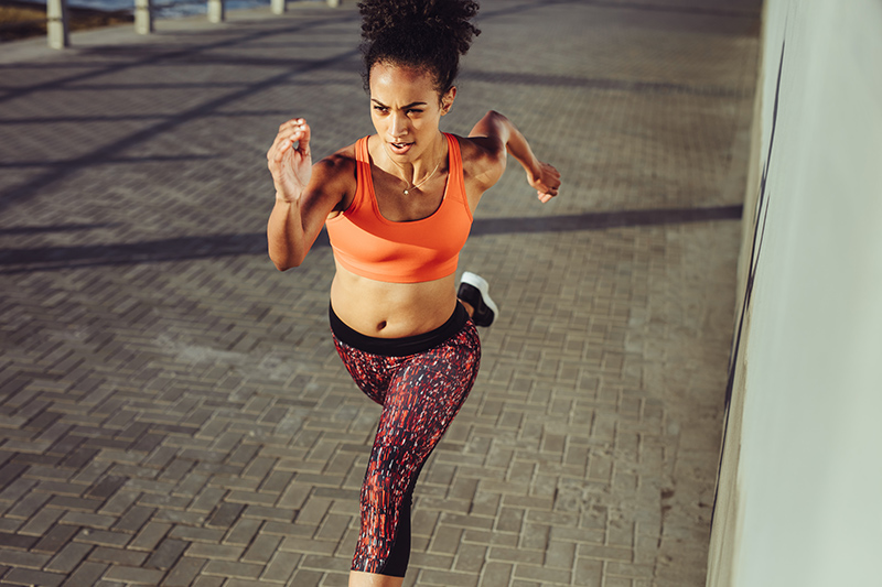 Woman doing HIIT Running Workout